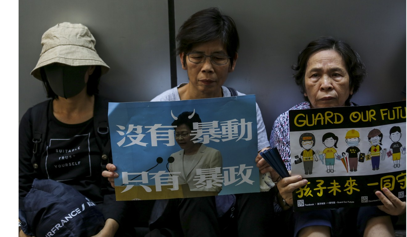 Elderly Hongkongers protest outside police headquarters in Wan Chai in support of alleged abuse victims
