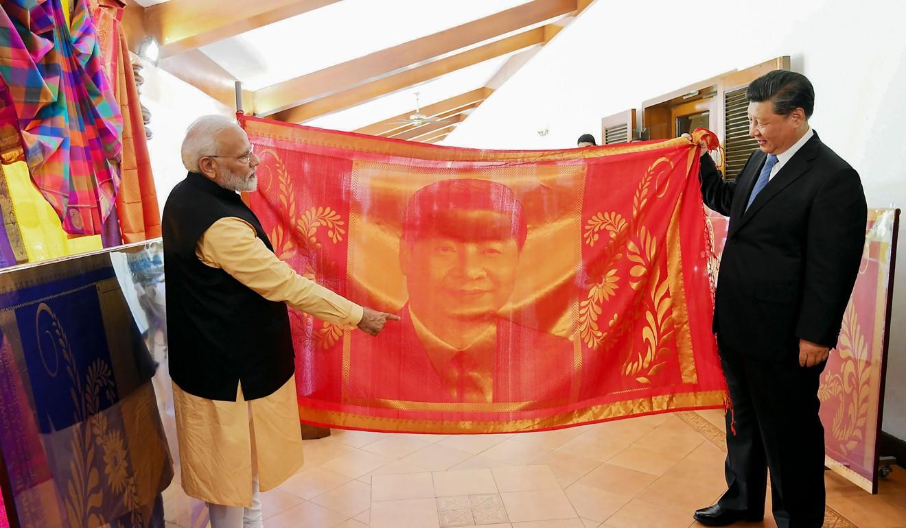 Xi, Modi agree to trim trade deficit, boost mutual trust amid US ...