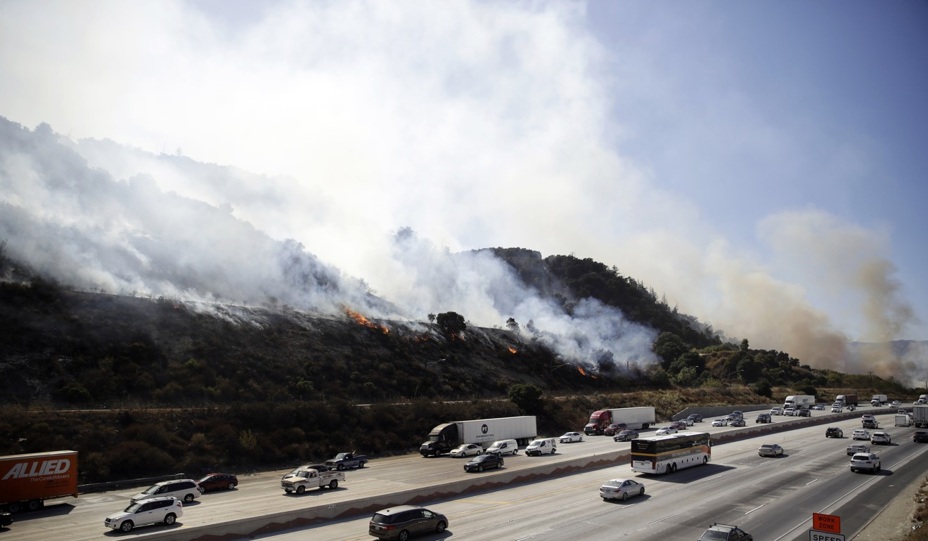 100,000 evacuated as firefighters battle to contain southern California blazes
