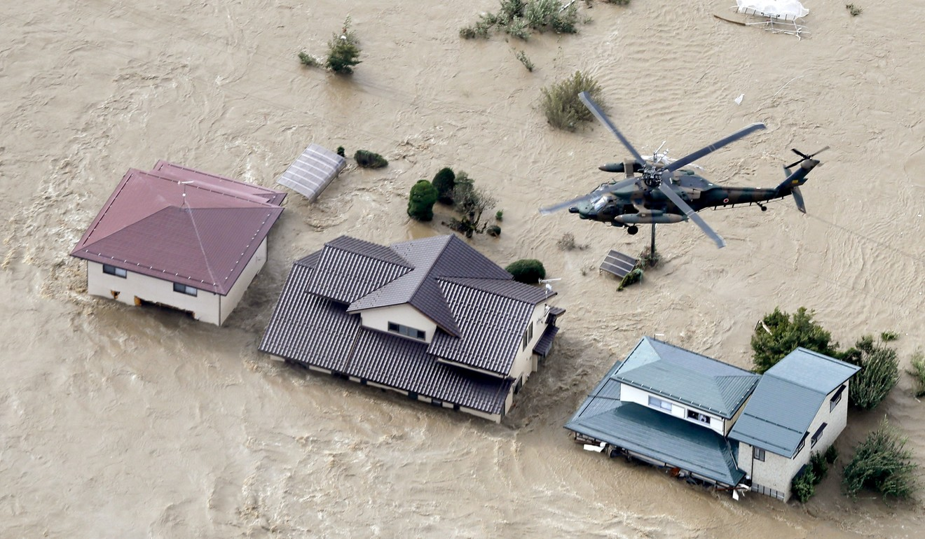 Typhoon Hagibis: military deployed after monster storm smashes Japan