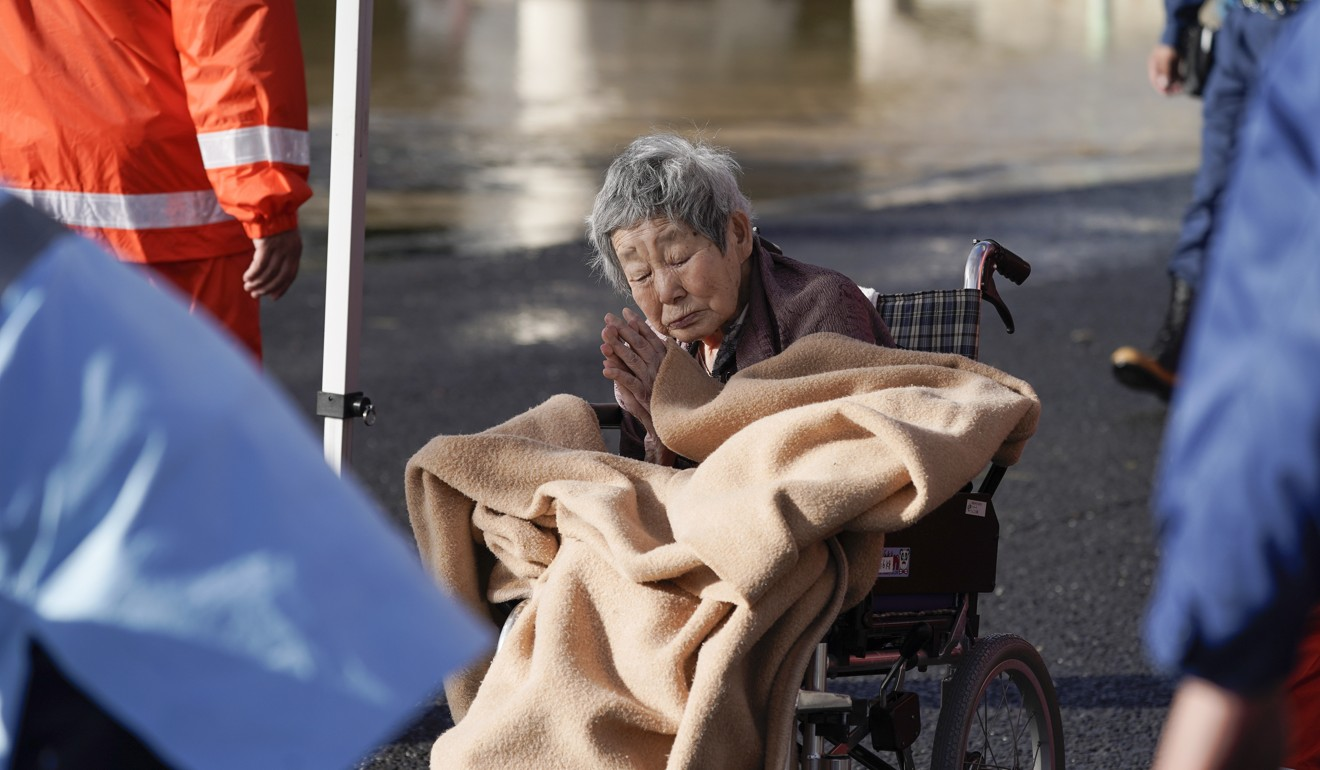 More than 100,000 Japanese rescuers work through the night as Typhoon Hagibis death toll climbs