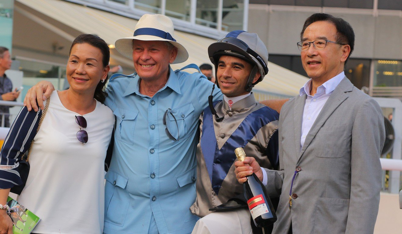 John Moore celebrates Aethero's victory with wife Fifi (left), jockey Joao Moreira and the winning owner. Photo: Kenneth Chan