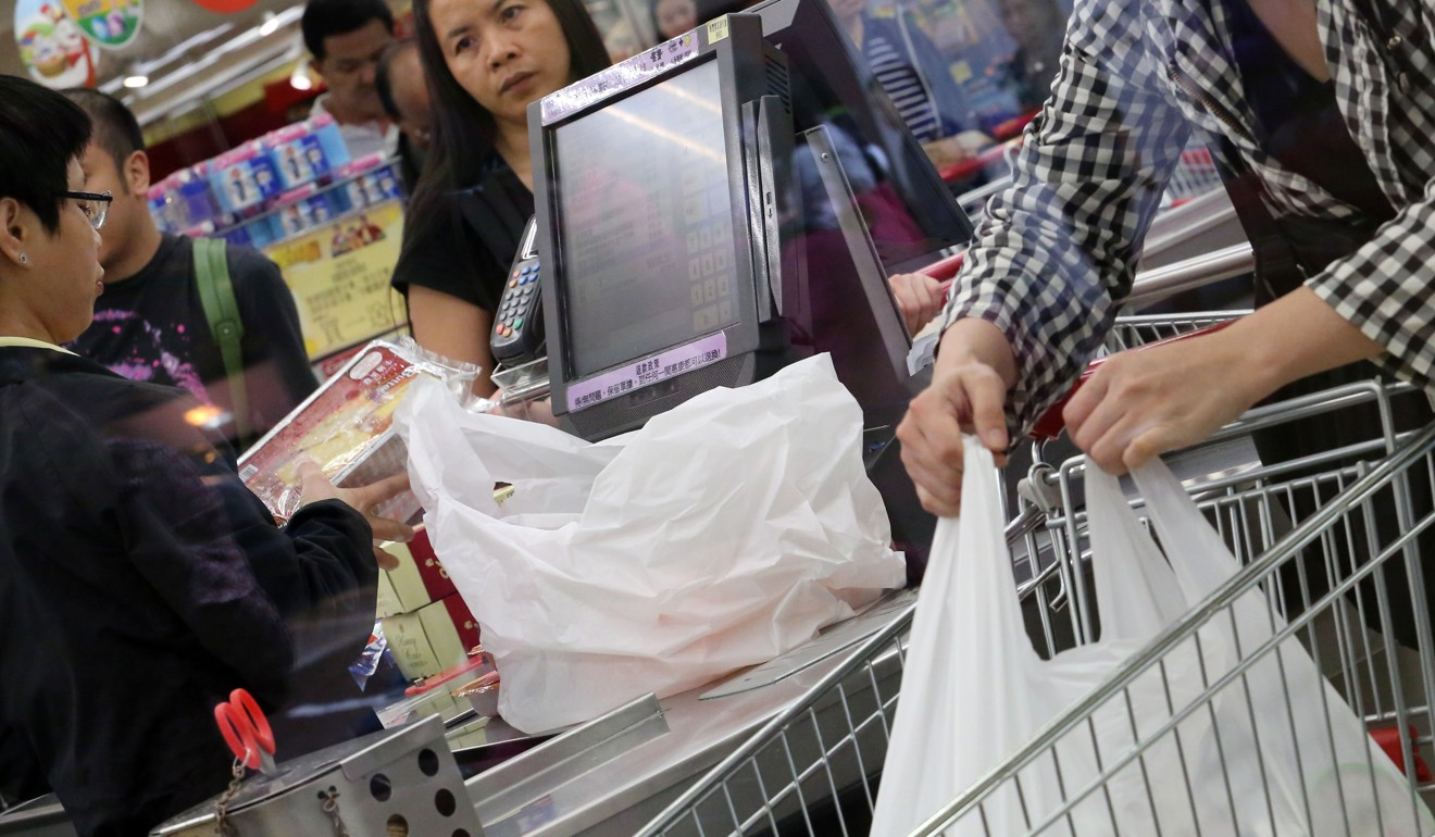 Hong Kong supermarkets dishing out clear plastic bags often with little regard for levy, green group survey finds
