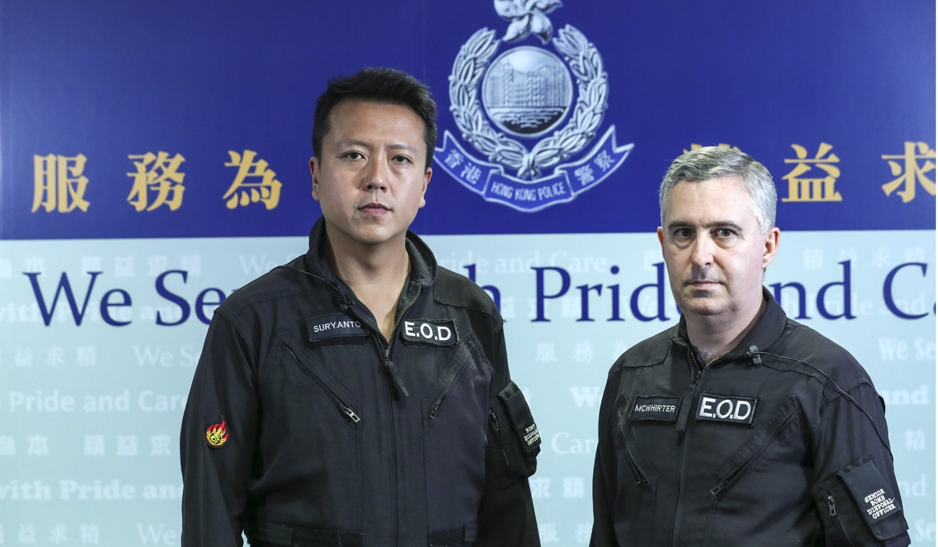Superintendent Suryanto Chin-chiu and Alick McWhirter at the police headquarters in Wan Chai. Photo: Sam Tsang