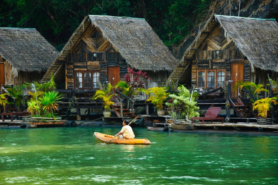 The Rafthouse hotel resort on the Kwai River in Sai Yok National Park in Kanchanaburi, Thailand. Photo: Alamy