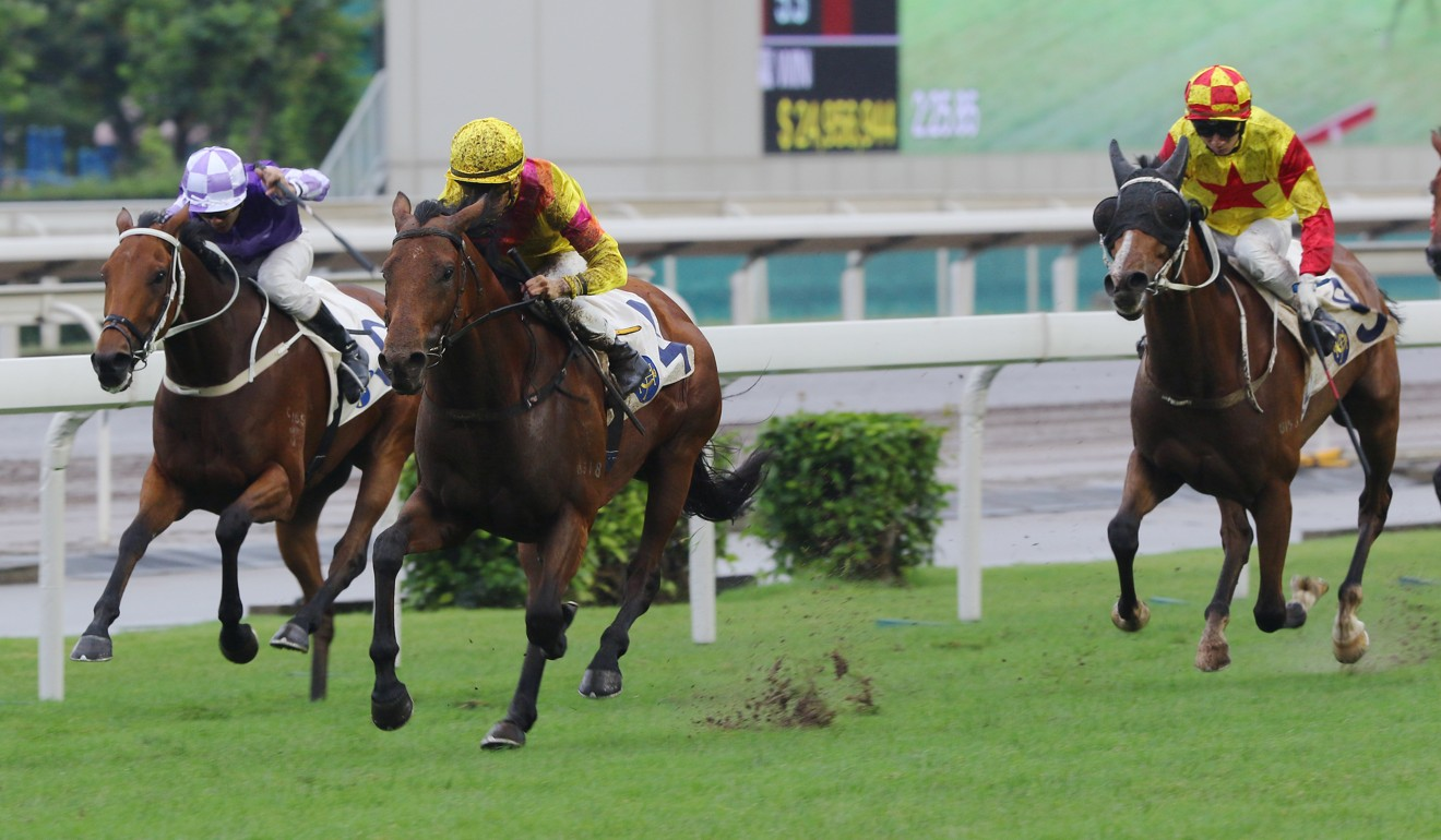 Ho Ho Khan races through the mud at Sha Tin.