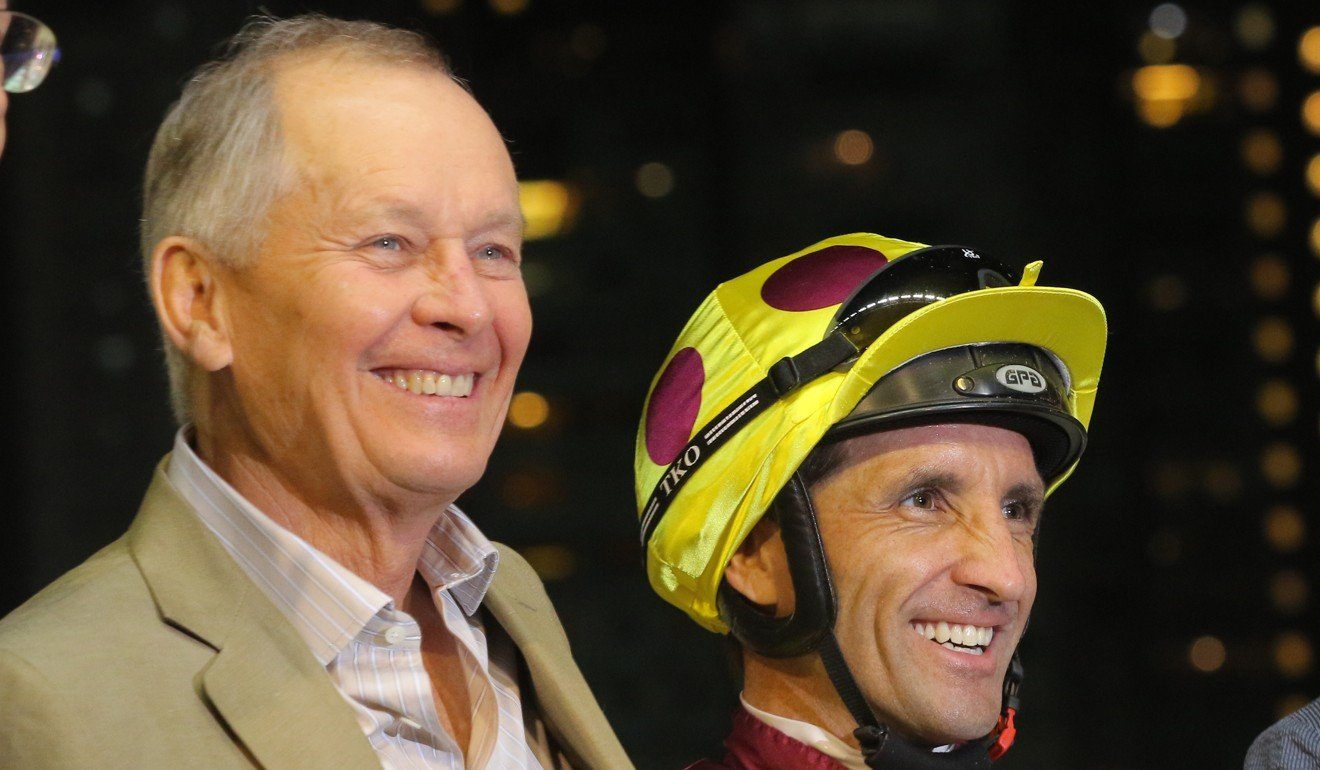 Trainer John Moore with jockey Neil Callan after Happy Warrior's win at Happy Valley on Wednesday night.