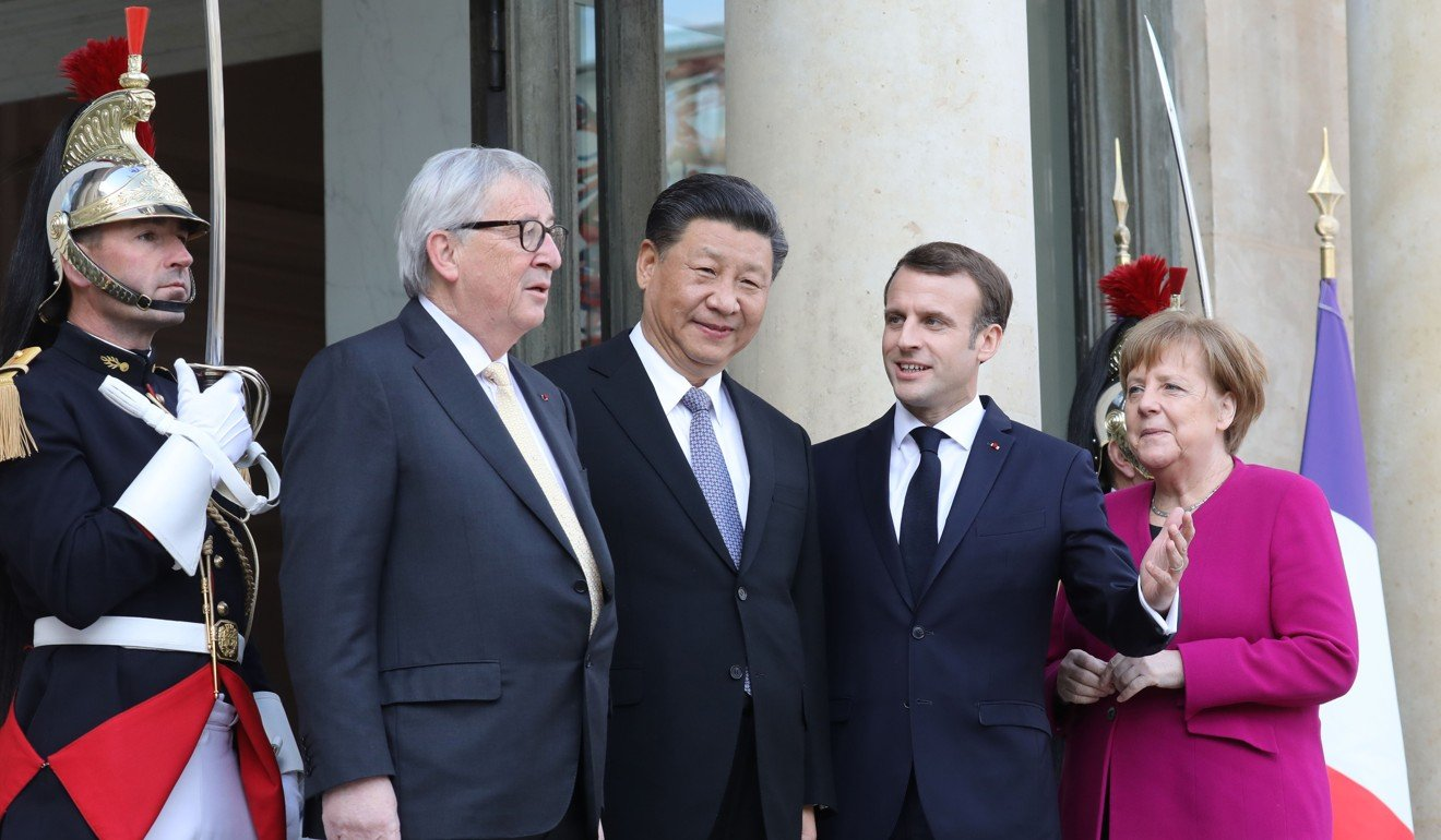 French President Emmanuel Macron invited Merkel and Jean-Claude Juncker to meet Xi Jinping in Paris in March. Photo: AFP