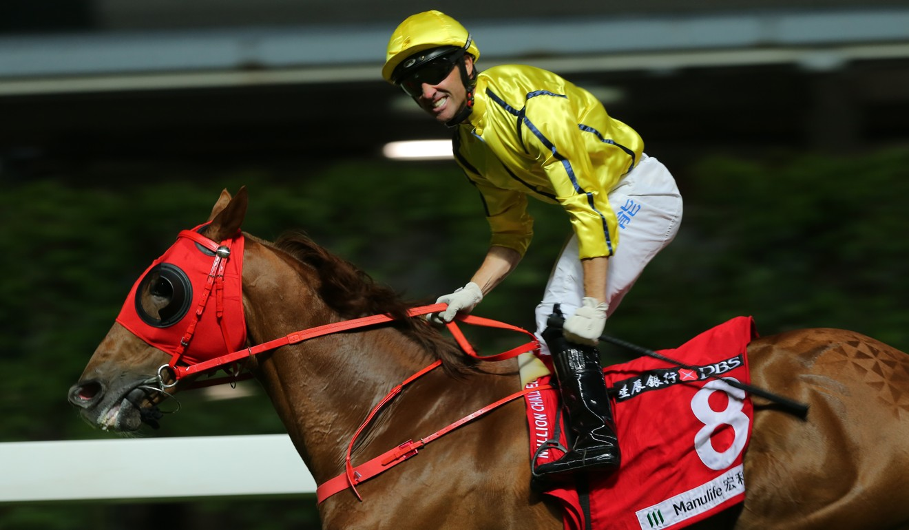 Neil Callan salutes on Owners' Star at Happy Valley.