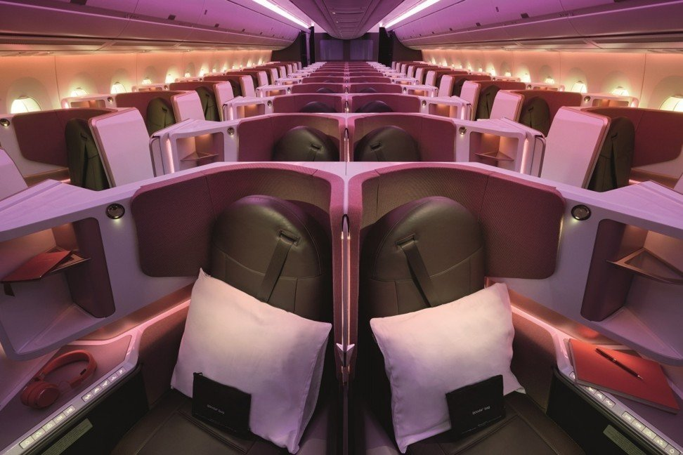 Virgin Atlantic's new 'Upper Class' section is brighter than on the rest of the fleet, with splashes of purple and coral.