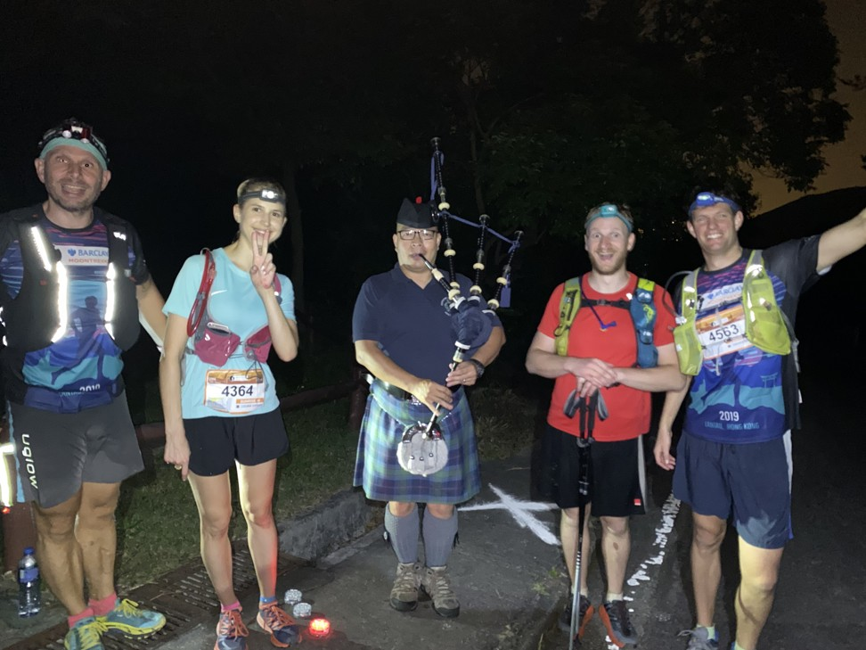 Mark Agnew and his team celebrate with a bagpiper at Moontrekker.