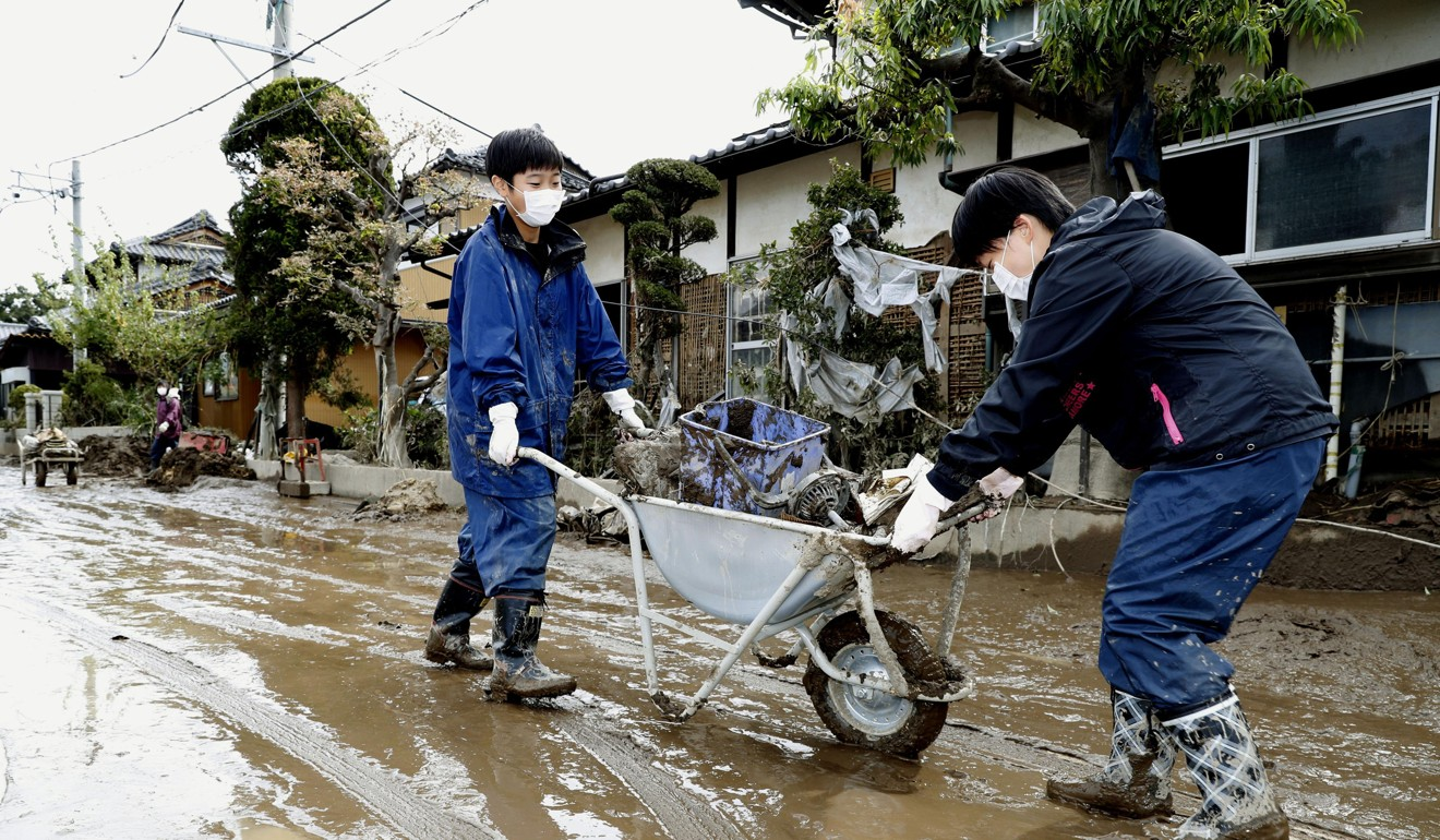 Areas hit by Typhoon Hagibis brace for more floods as heavy rain falls in Japan