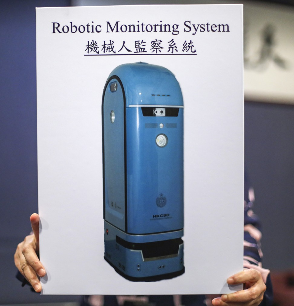 Robot warders check on inmates as Hong Kong tests 'smart prison' devices to step up security, surveillance