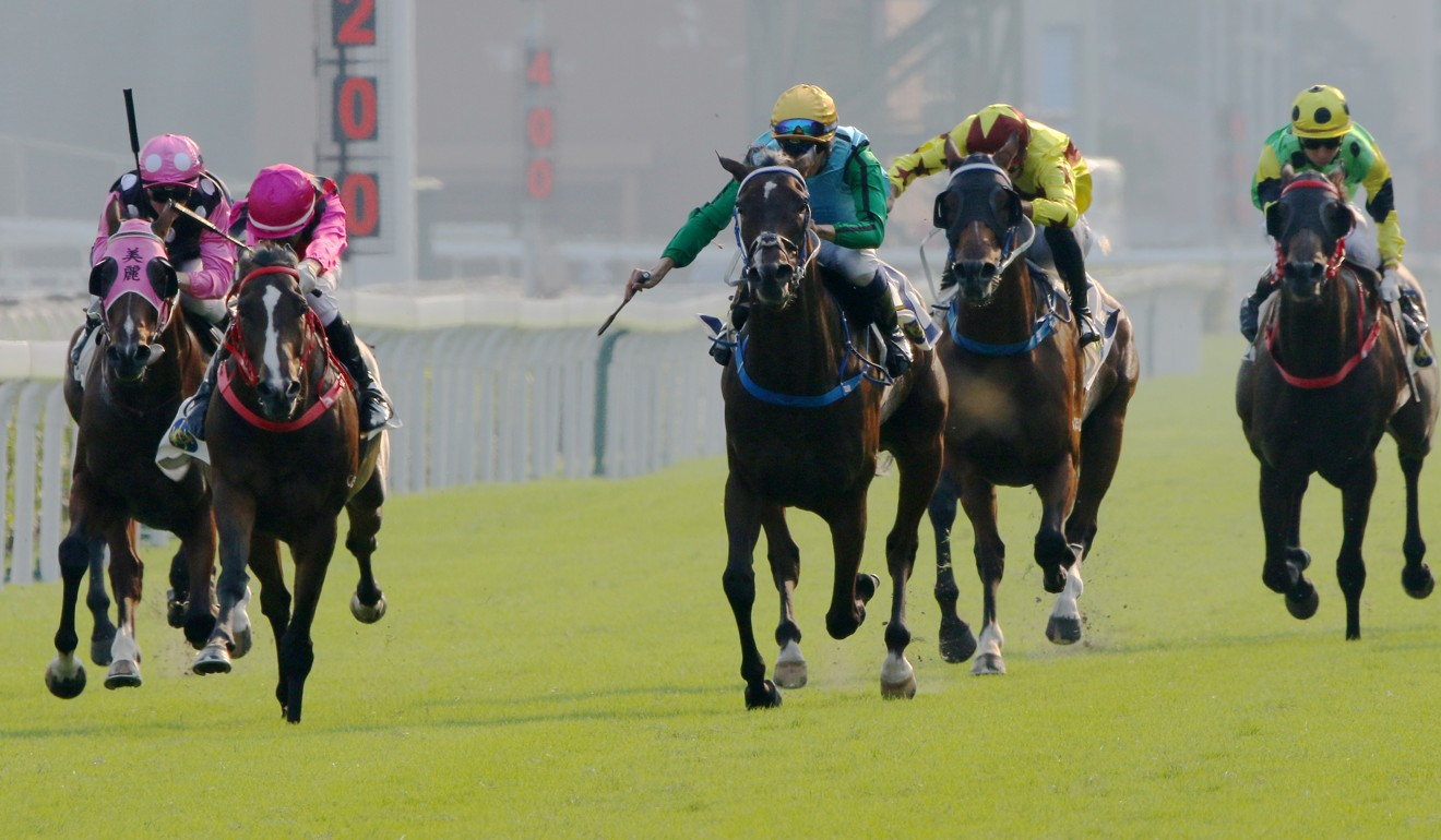 Rise High (right) and Waikuku (left) go past Beauty Generation in the straight at Sha Tin.