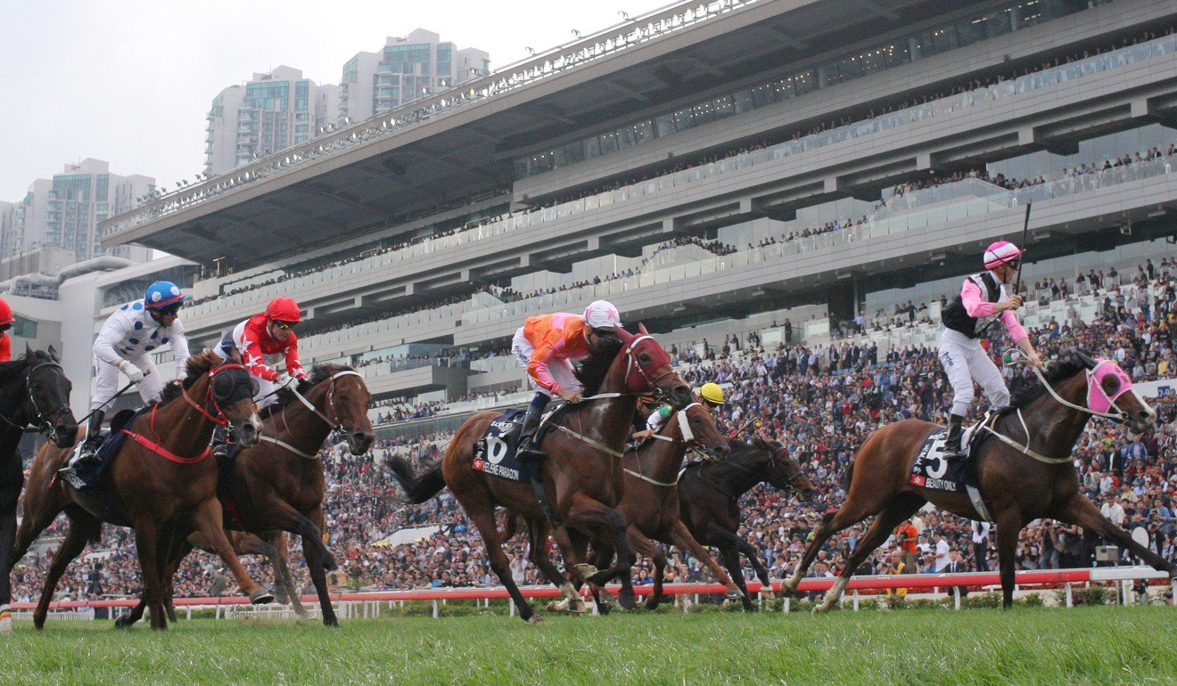 Joyful Trinity (second from left) runs behind Beauty Only in the Group One Hong Kong Mile in 2016.