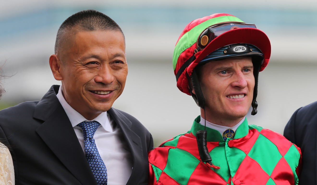 Trainer Danny Shum and Zac Purton celebrate Regency Legend's win in September.