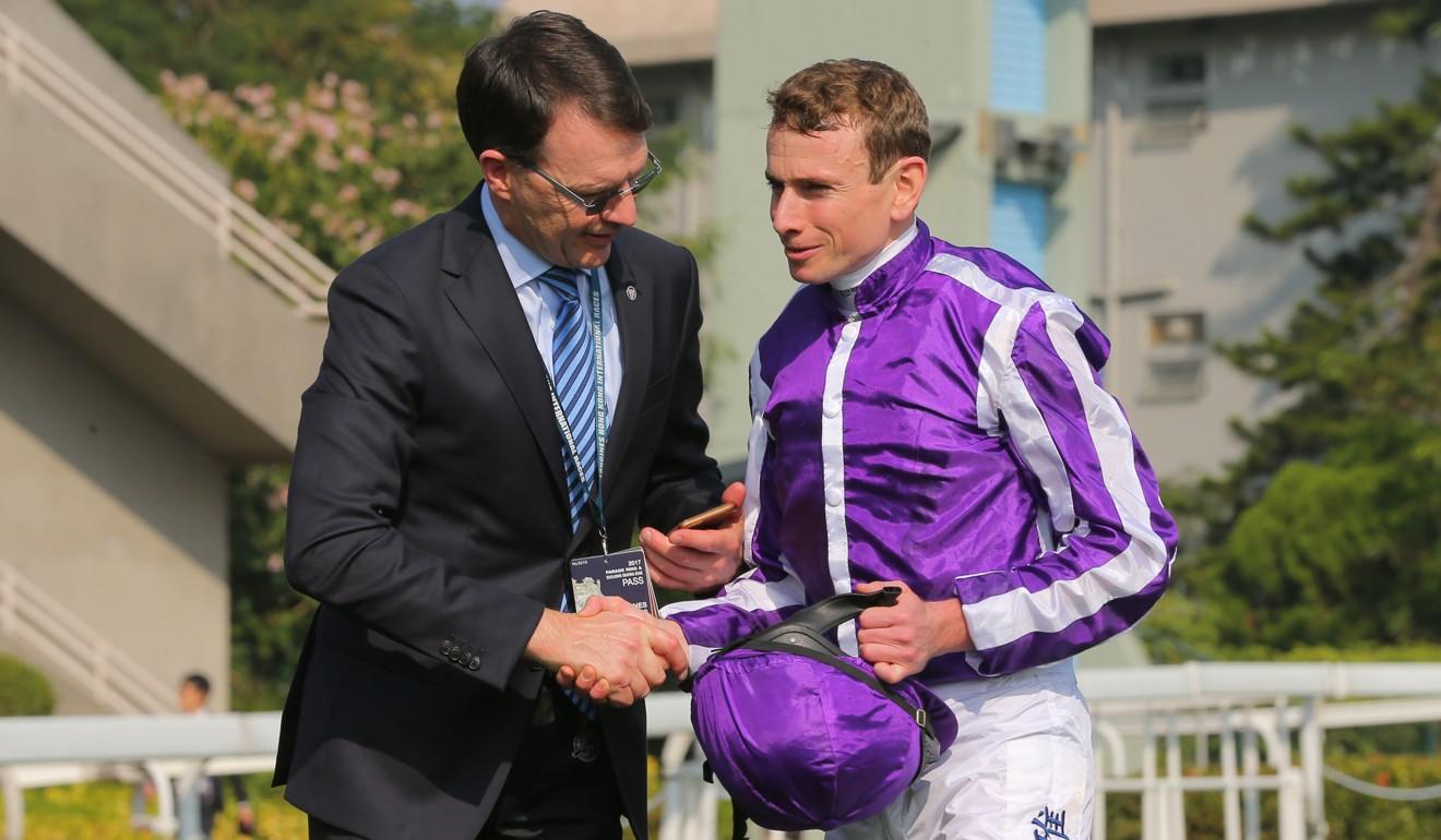 Trainer Aidan O'Brien with jockey Ryan Moore after winning the Hong Kong Vase.
