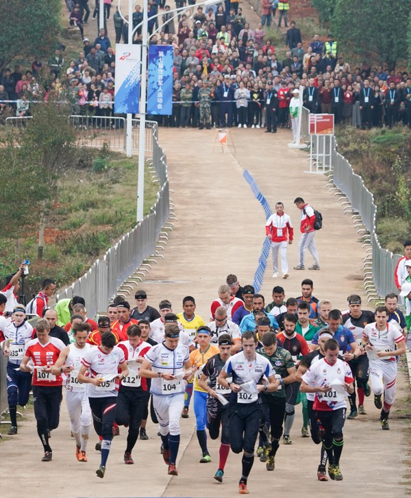 Athletes start off during the men's relay orienteering final at the CISM Military World Games in Wuhan. Photo: Xinhua