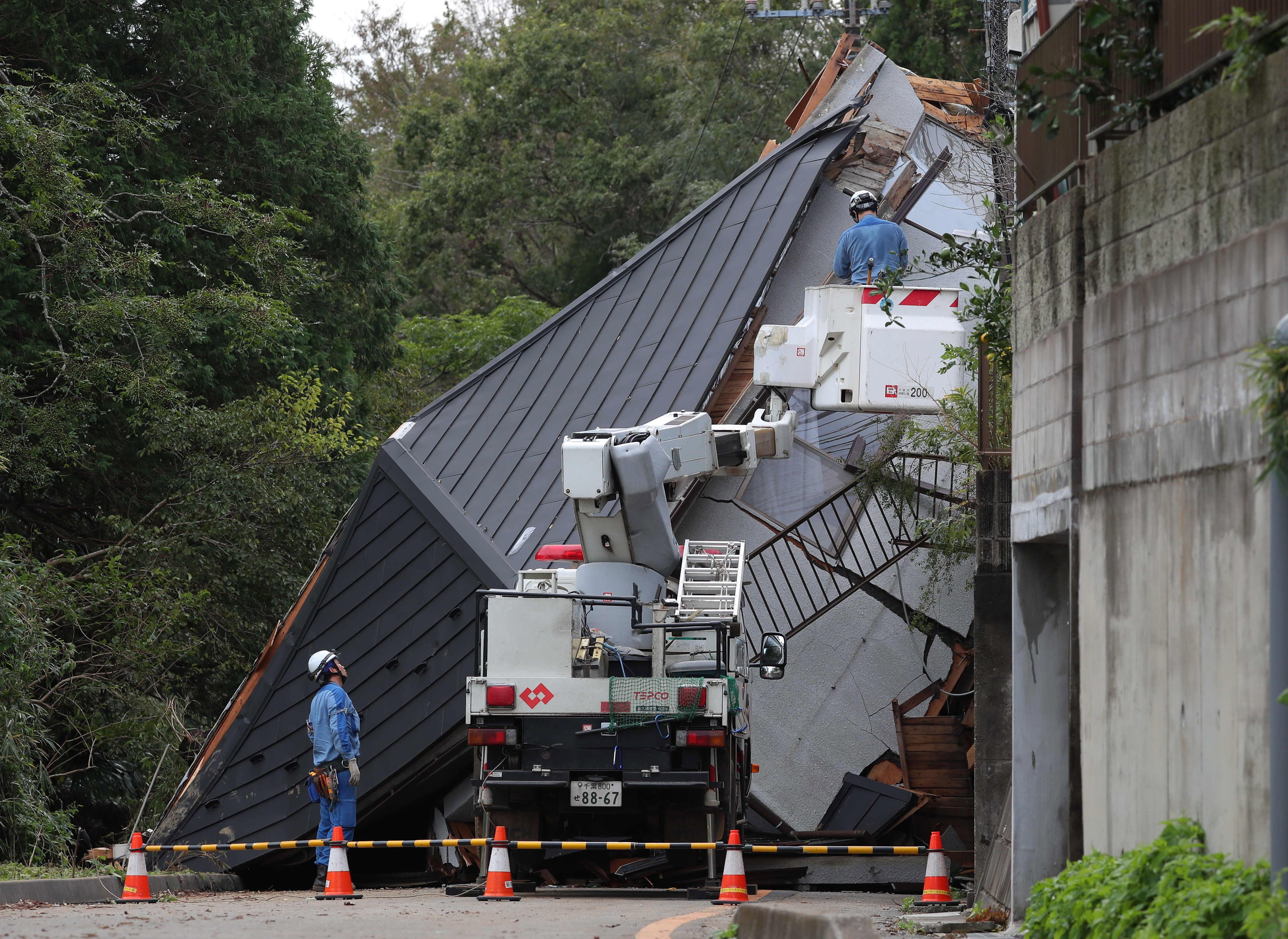 At least 10 killed in landslides and floods as torrential rain lashes eastern Japan