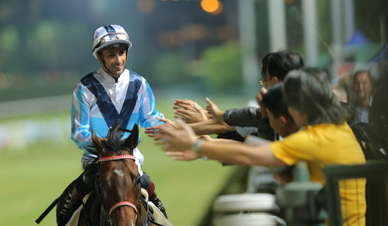 Alberto Sanna celebrates with fans after a winner at Happy Valley.