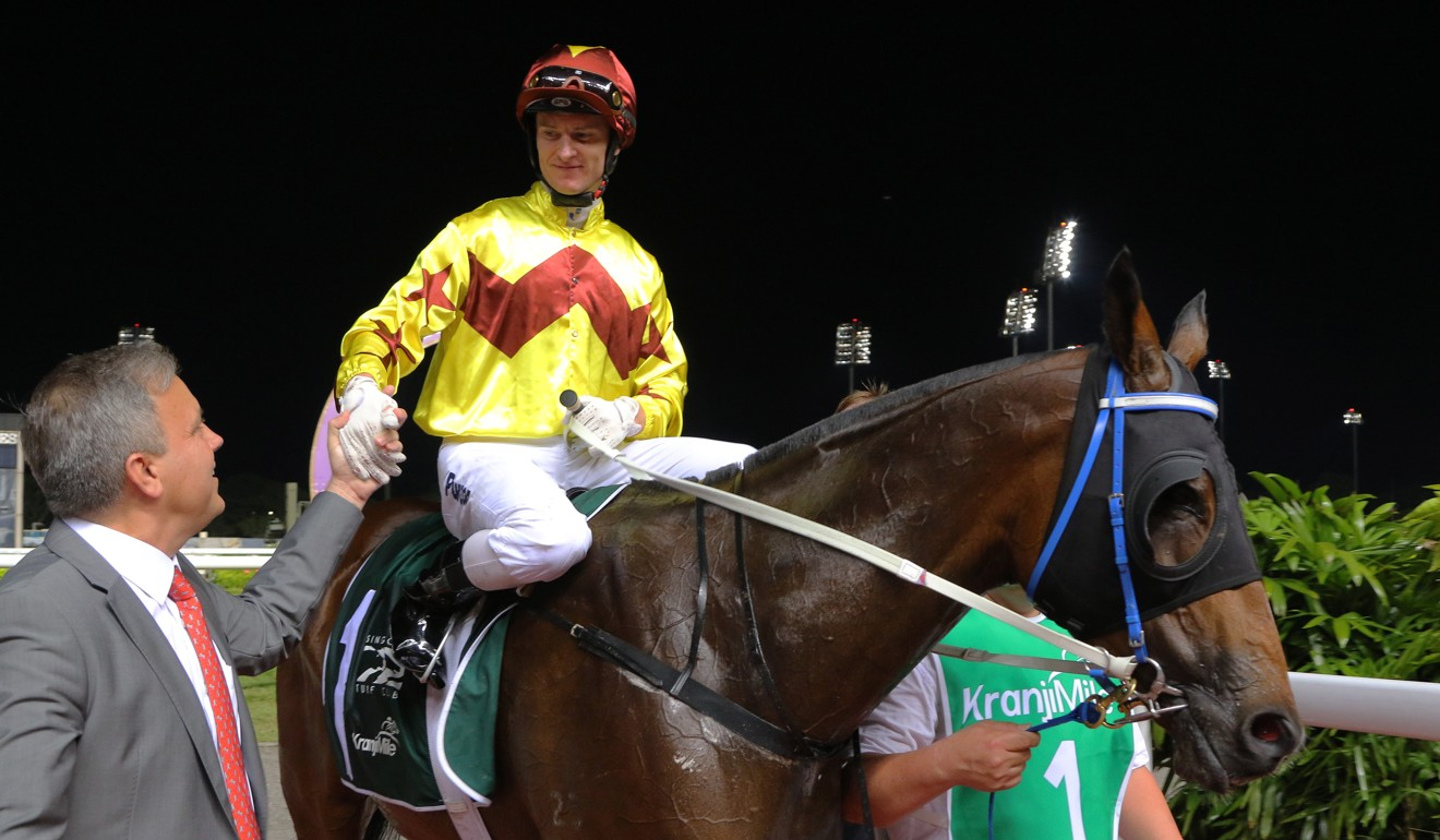 Jockey Zac Purton and trainer Caspar Fownes after winning with Southern Legend in Singapore.