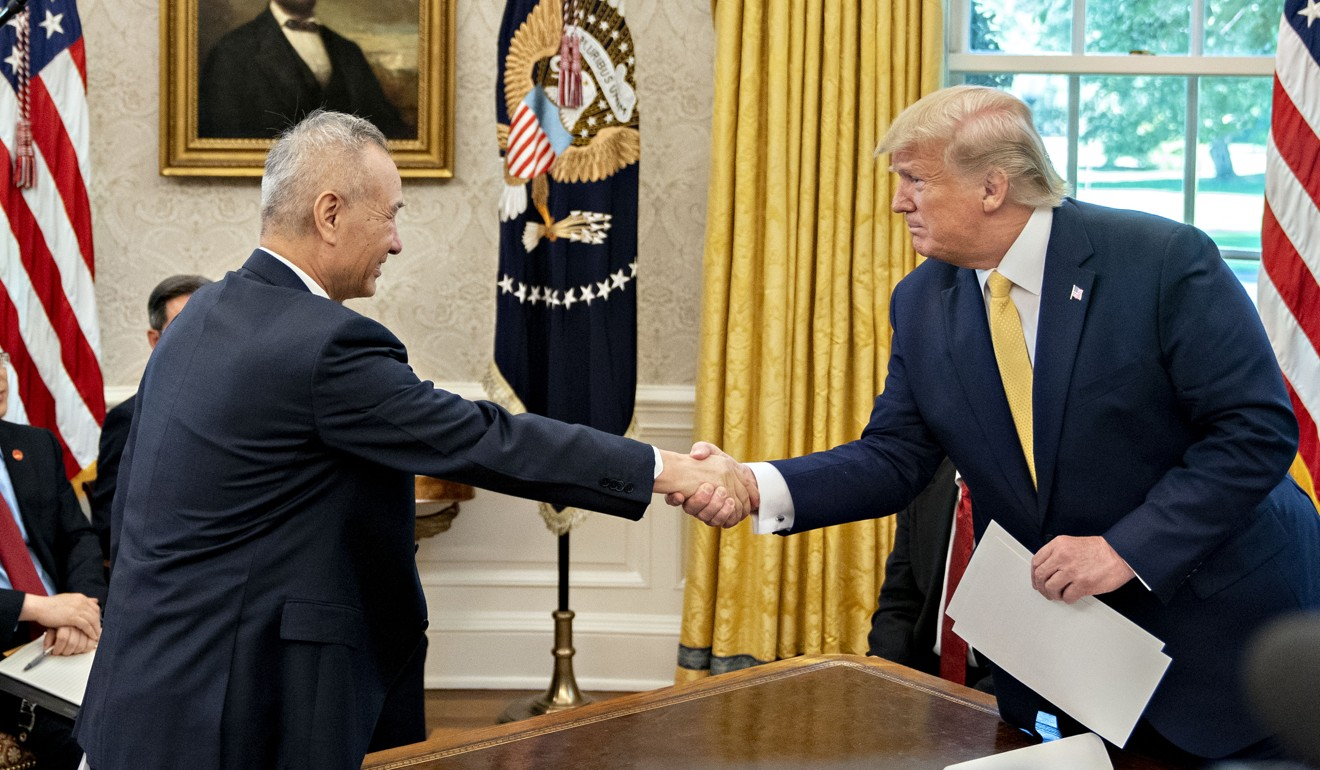 US President Donald Trump shakes hands with China's vice-premier Liu He at a meeting in the Oval Office on October 11, 2019. Photo: Bloomberg
