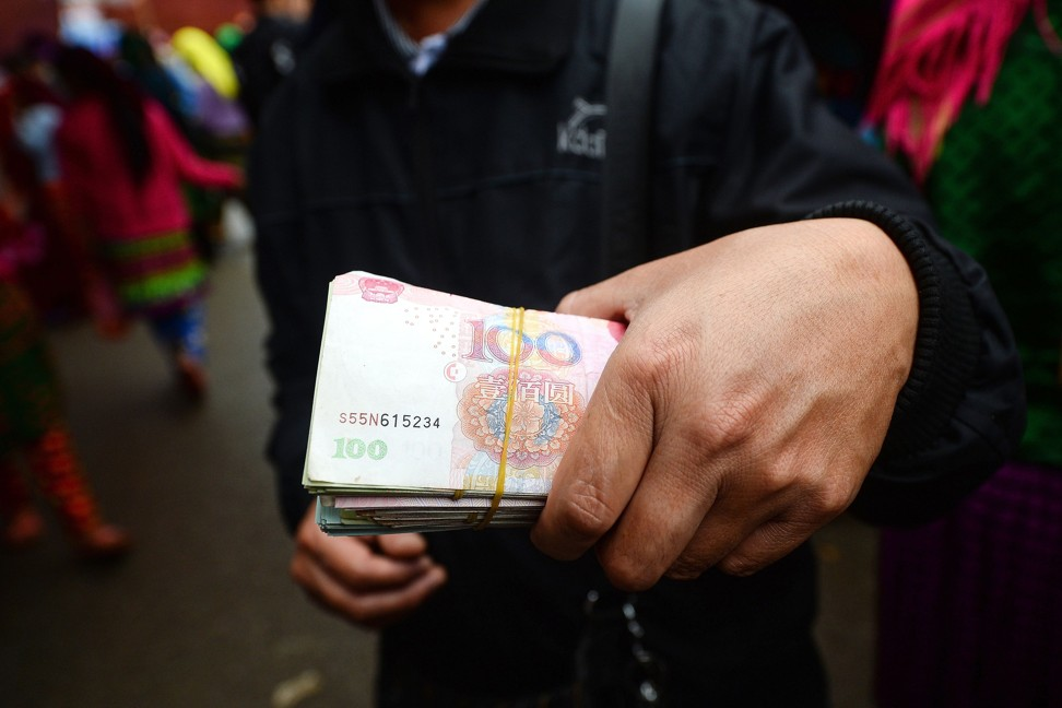 The yuan jumped by 0.59 per cent to 6.9890 on Tuesday, breaking a key resistance level of 7.00 to the dollar. Photo: AFP