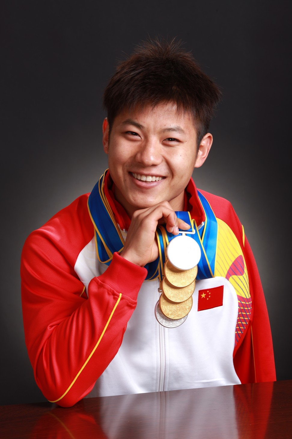 Wang Jiachao after the 2010 Asian Games in Guangzhou, proudly displaying his three golds and two silver medals.