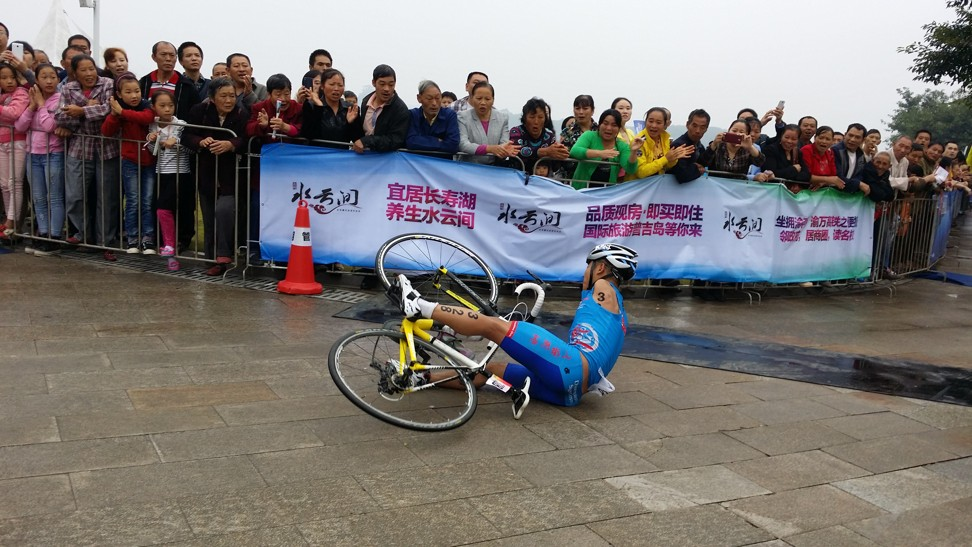 Wang crashing on his bike during an amateur triathlon in China in 2015. He was overall champion, beating all the able-bodied athletes.