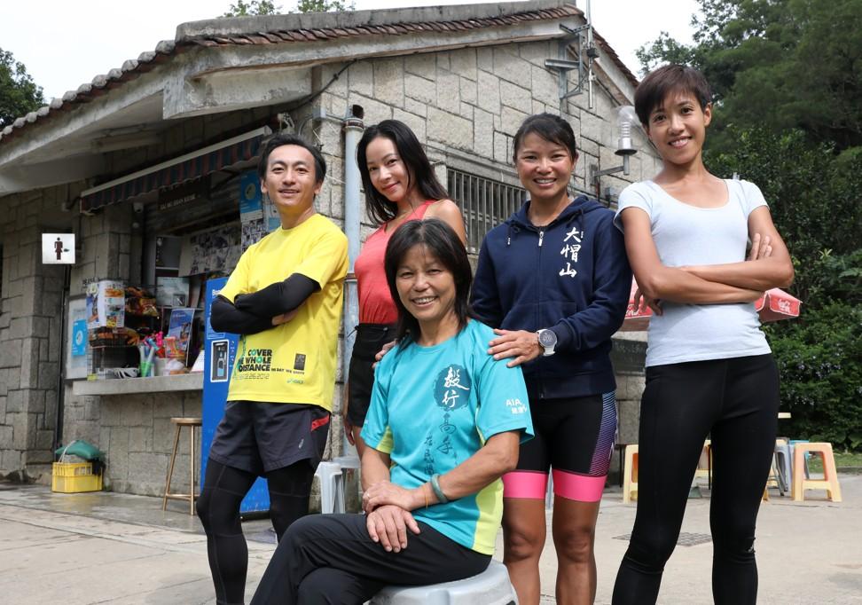 (Back row from left): Race organisers Allan Lee Aka-fai; Hidy Yu Hui-tung; race organisers Wyan Chow Pui-yan and Ami Yau Mei-ling, with Connie Kong For-lin (front), at the Tai Mo Shan Kiosk.