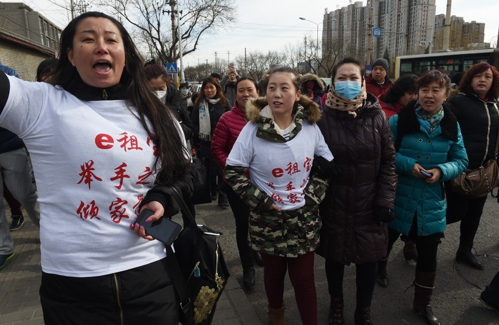 Investors in Chinese online peer-to-peer lender Ezubao chanting slogans during a protest in Beijing after the platform turned out to be a giant Ponzi scheme. Photo: AFP