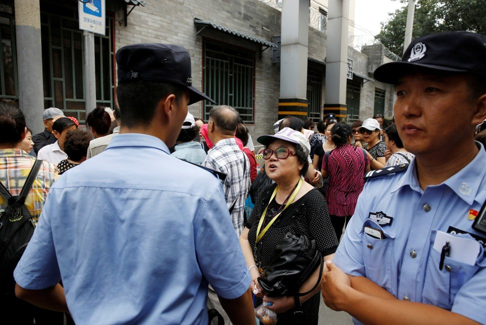 People protest over losses incurred in peer-to-peer investment schemes in front of the public security ministry of Dongcheng district in Beijing. Photo: Reuters