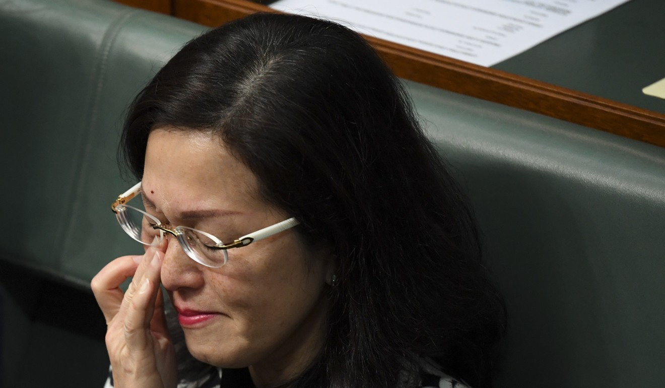 Hong Kong-born Australian MP Gladys Liu wipes away a tear as the prime minister defends her in parliament on September 12 against accusations that she is under Beijing's influence, after a Chinese flag was raised at the Box Hill police station in her federal electorate of Chisholm. Photo: EPA-EFE