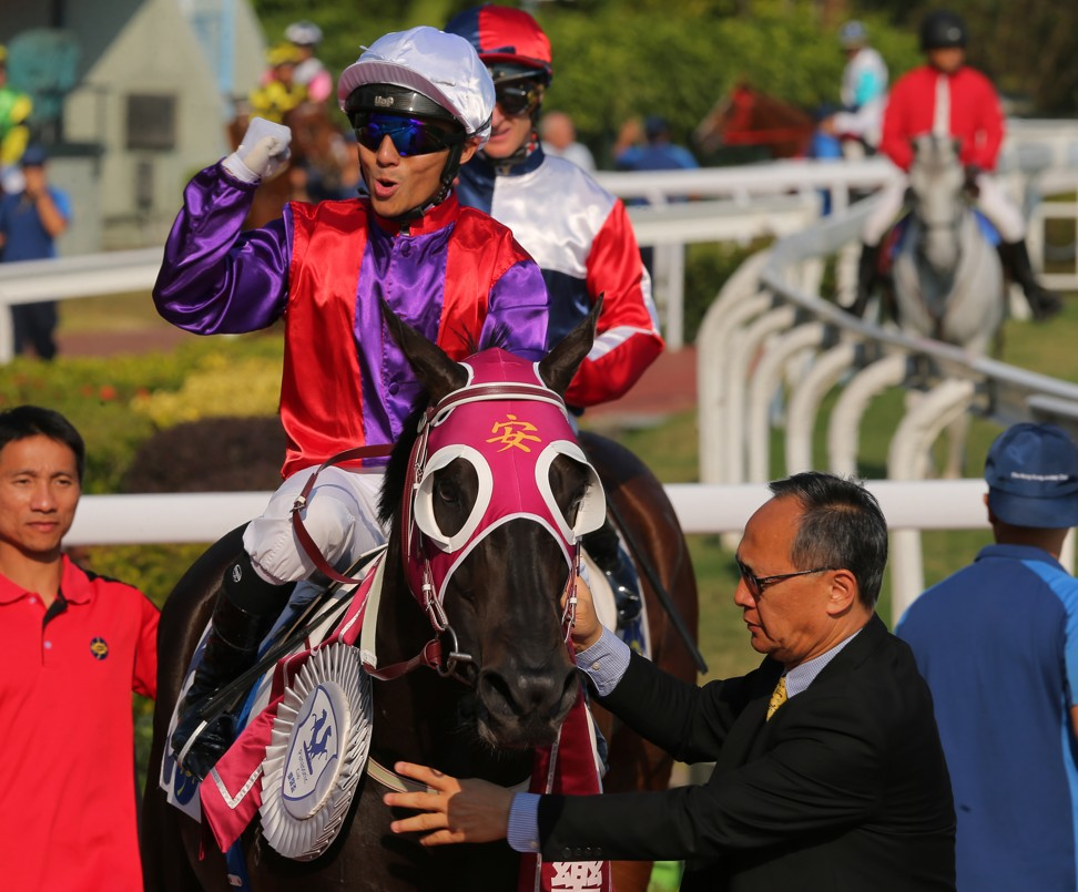 Alfred Chan pumps his fist after winning with Encouraging.