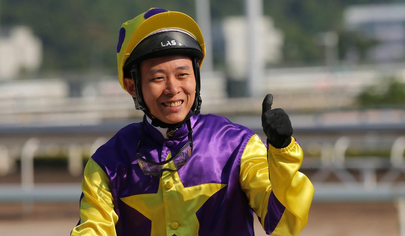 Alex Lai salutes after winning on Mongolian Legend.