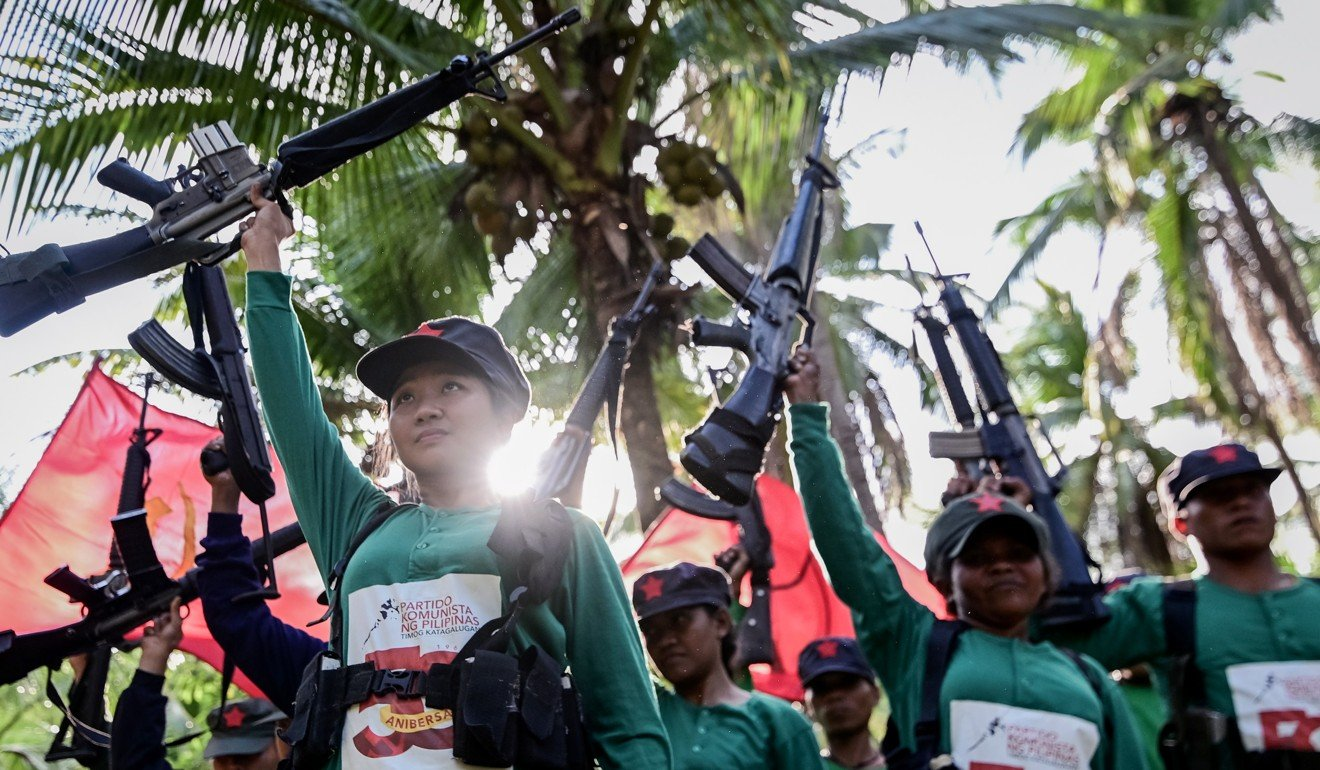 Fighters of the New People's Army conduct a drill during an event to mark the 50th anniversary of its founding in March. Photo: EPA