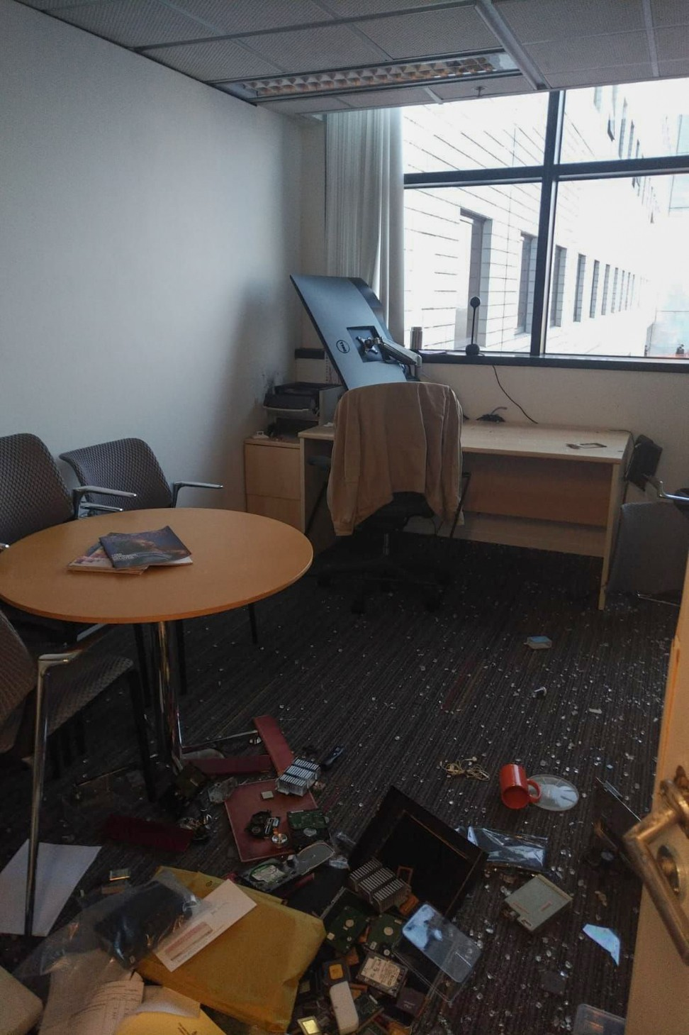 The office of Professor Xu Jiang, a mainlander teaching in the department of Electronic and Computer Engineering, was smashed by violent protesters on Friday. Photo: Xu Jiang