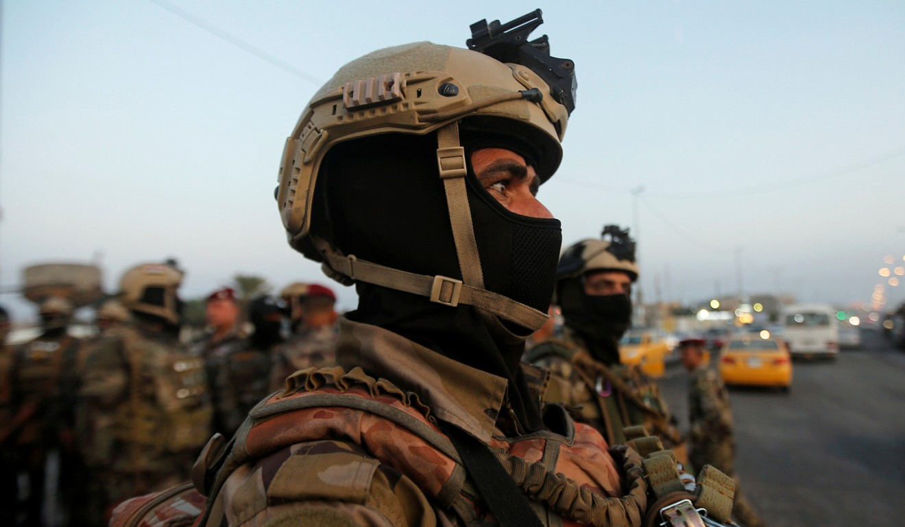 Members of Iraqi security forces are seen during the ongoing anti-government protests in Basra. Photo: Reuters
