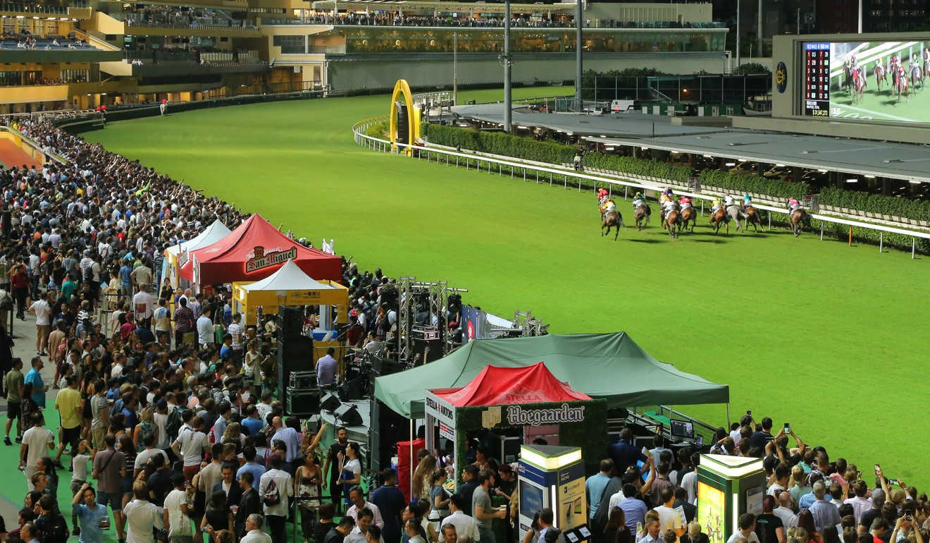 Horses race at Happy Valley.