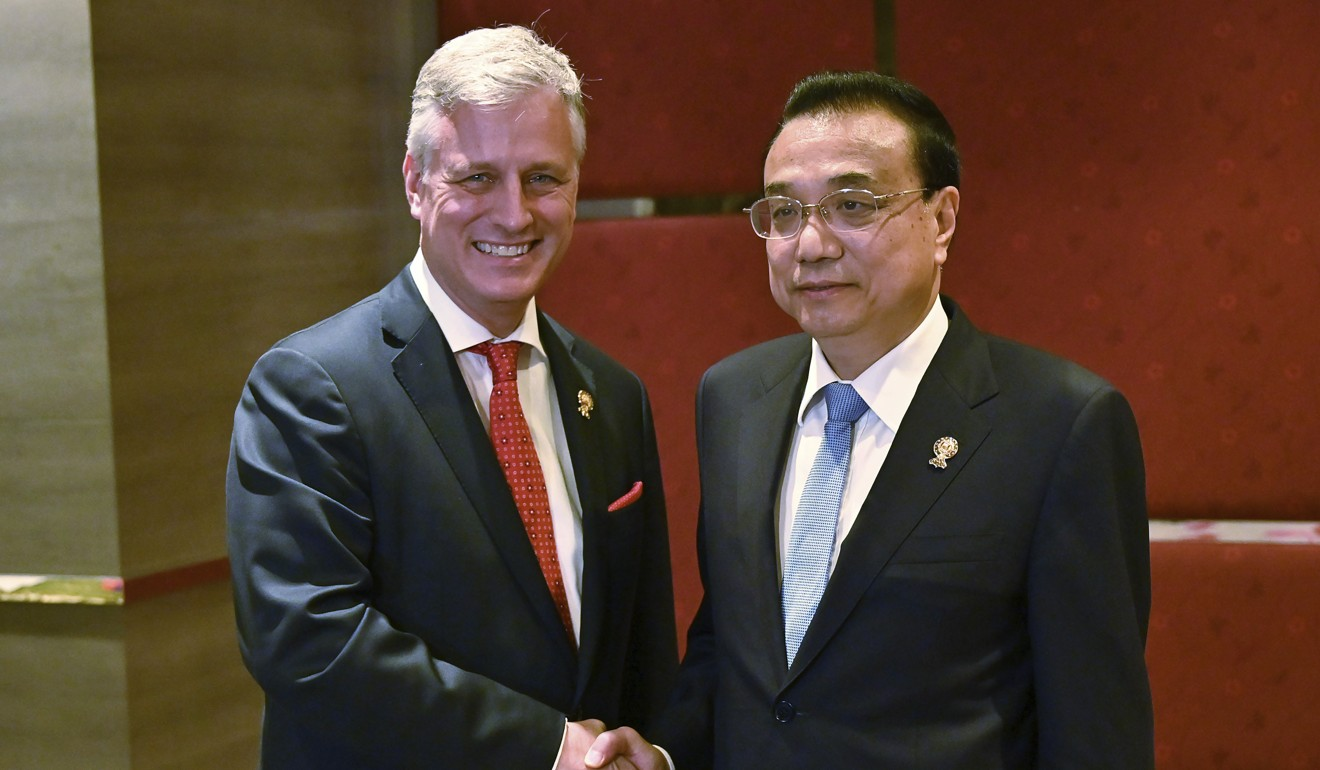 US National Security Adviser Robert O'Brien with Chinese Premier Li Keqiang on the sidelines of the Asean Summit in Bangkok. Photo: AP