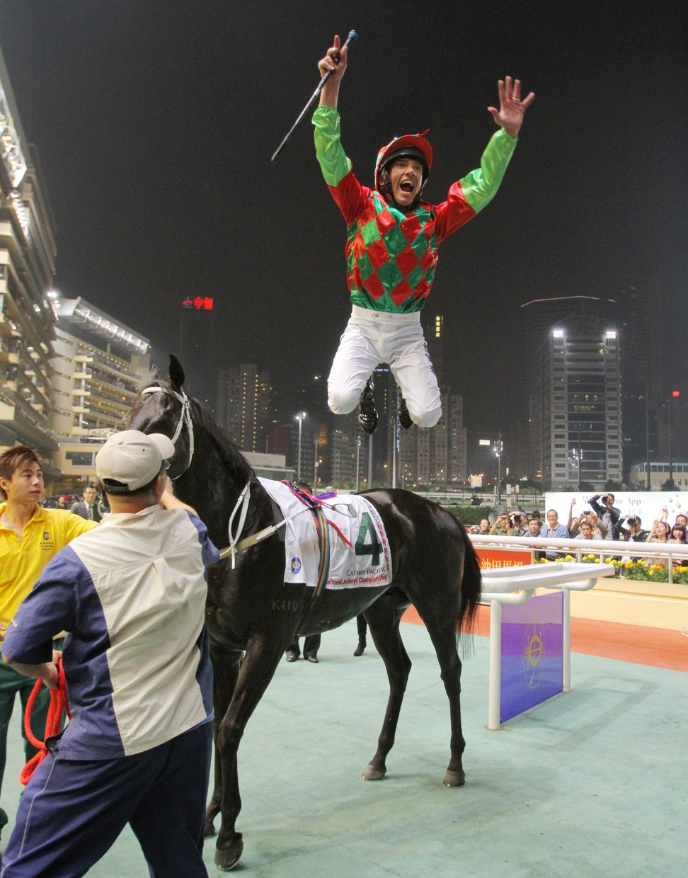 Frankie Dettori jumps in the air after winning a race at Happy Valley in 2011.