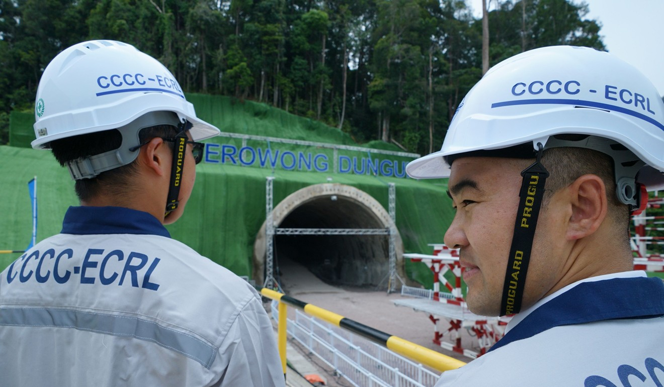 China Communications Construction Company workers in front of the tunnel being built for the East Coast Rail Link (ECRL) project. Photo: AFP