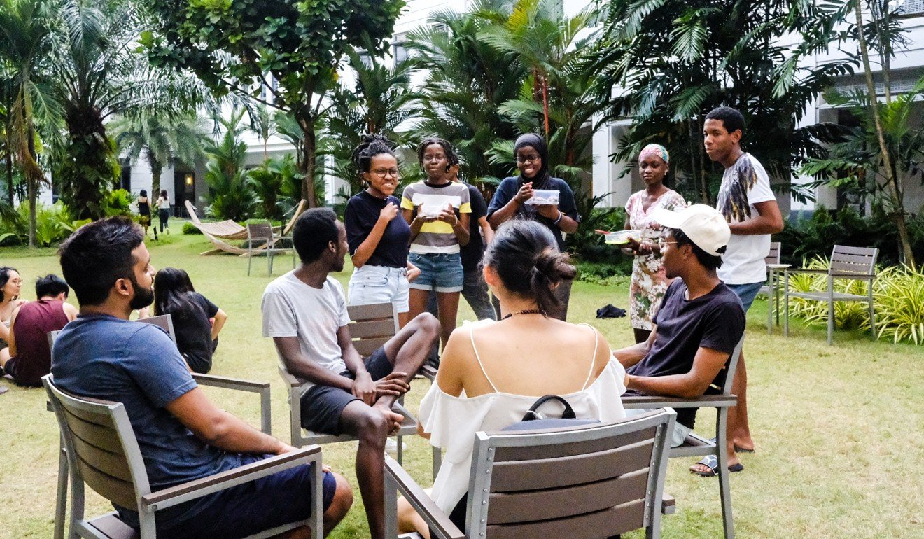 Students and guests mingling at a casual Sunday cookout organised by the Yale-NUS Afro Society. Photo: Toh Ee Ming