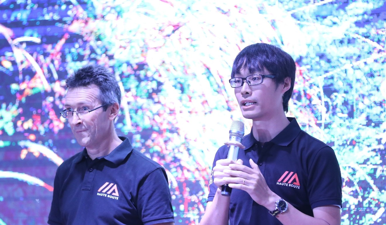 Harry Li on stage during a briefing at the recent Haute Route event in China where he was a bilingual co-announcer. Photo: Haute Route