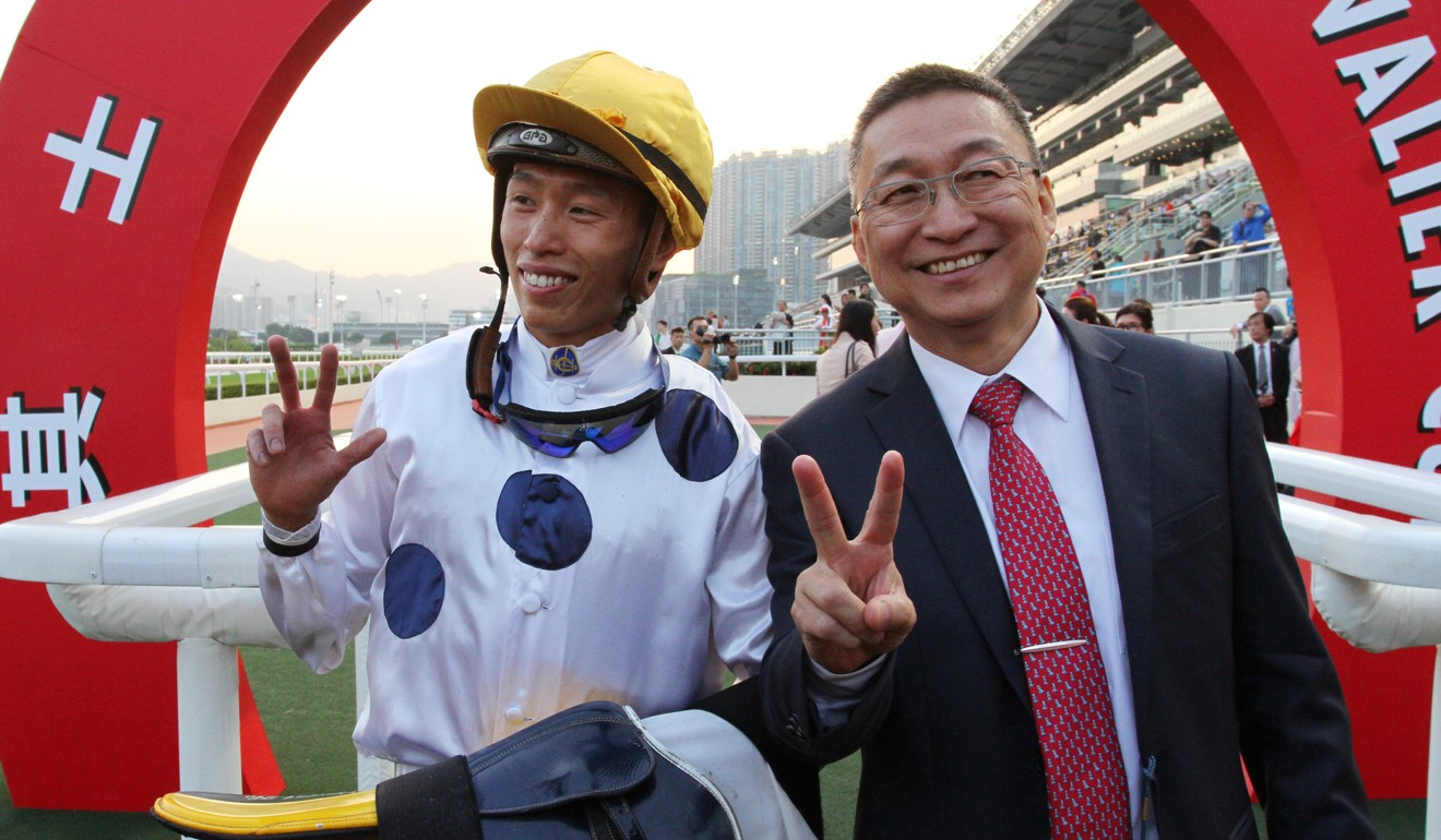 Jockey Vincent Ho and trainer Francis Lui celebrate their double together.