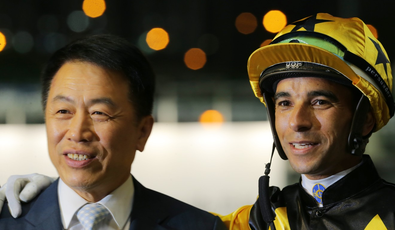 Trainer Ricky Yiu and Joao Moreira after the win of King's Trooper.