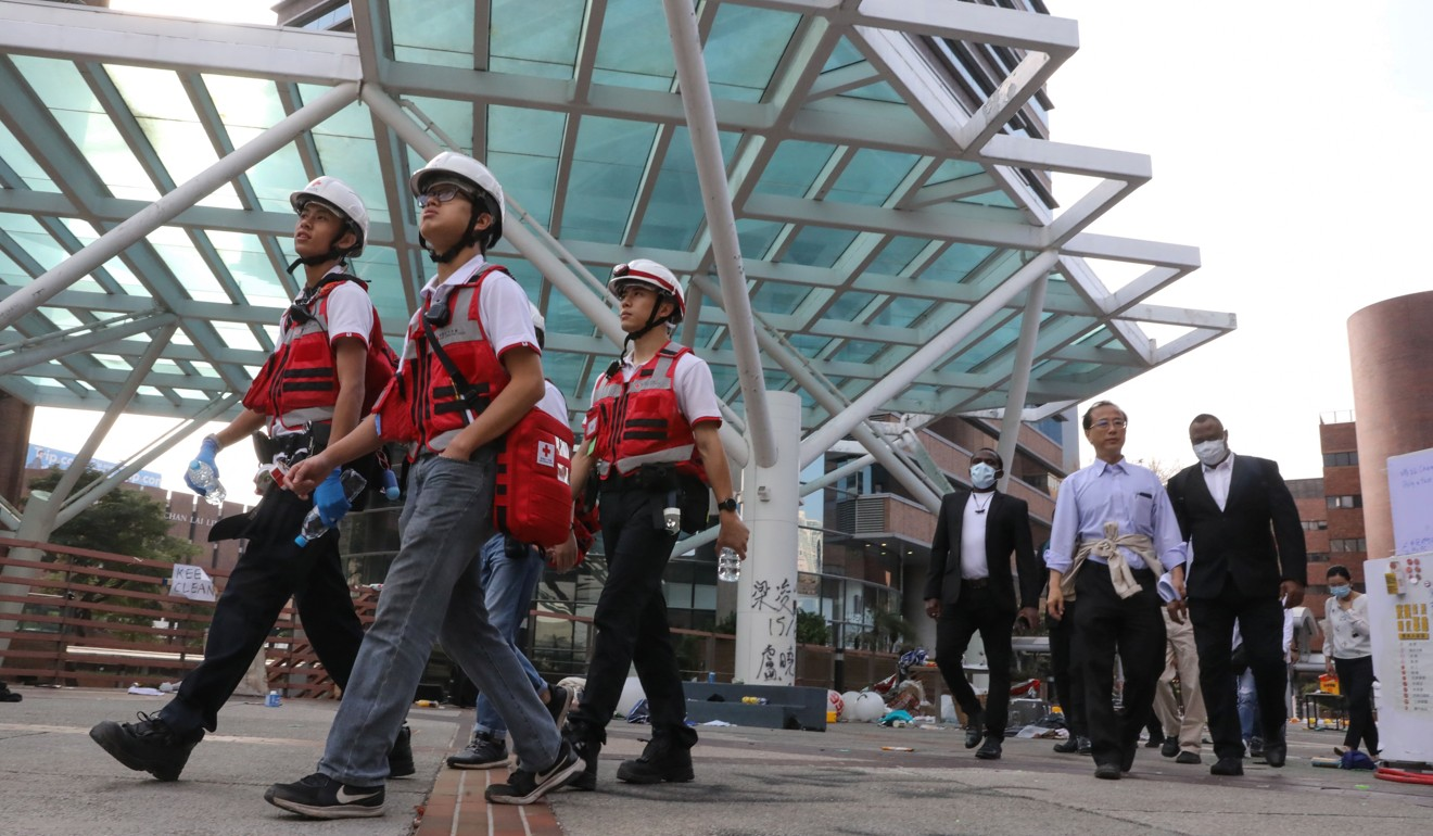 Red Cross first-aiders and Polytechnic University staff search the campus on Wednesday. Photo: K.Y. Cheng
