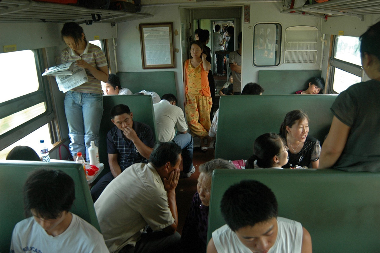 "Passengers aboard train No 1470, from Xuzhou, in Jiangsu, to Harbin, Heilongjiang province, in July 2008. ""This is the year I began to record the green trains. Ten days after I took this photo, high-speed rail began between Tianjin and Beijing,"" says Qian Haifeng. Photo: Qian Haifeng"
