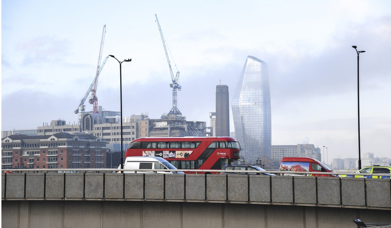 Buses and cars remain on London Bridge after it was closed to traffic and the public after the attack on Friday. Photo: AP