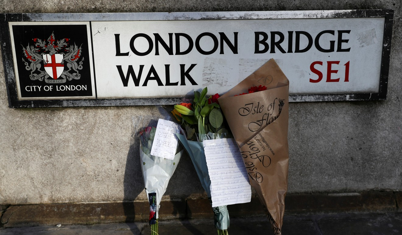 Flowers are left at the scene of a stabbing on London Bridge. Photo: Reuters